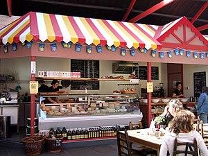 Market delicatessen Stall selling Spanish chee...