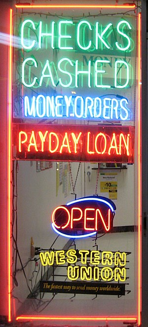 A shop window advertising payday loans.