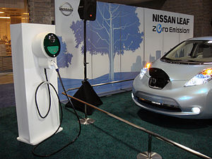 Nissan Leaf electric vehicle and recharging st...