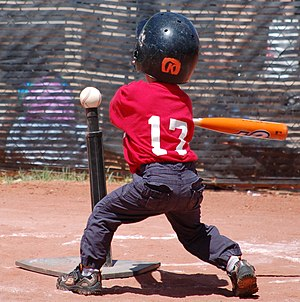 English: A right-handed tee ball player swings...