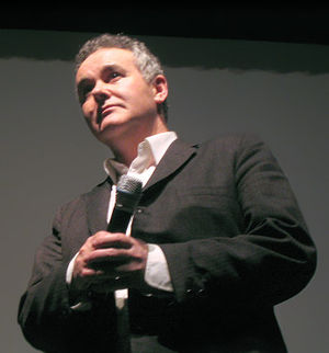 Adam Curtis speaking on stage at the San Frans...