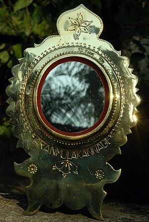 English: This is a metal mirror created from s...