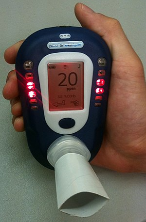 Breath carbon monoxide monitoring device displ...