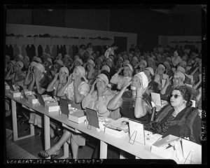 Title: Audience of women applying makeup at le...