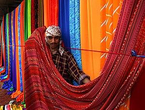Sunday textile market on the sidewalks of Kara...