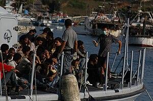 English: Migrants arriving on the Island of La...