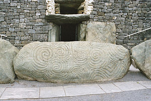 Entrance stone with megalithic art.