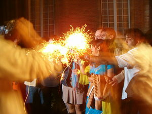Playing with sparklers on Diwali.