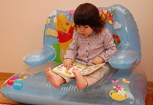 English: Azerbaijanian girl Leman reading a book.
