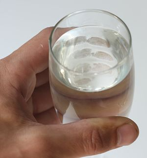 English: Fingerprints on a glass of water made...
