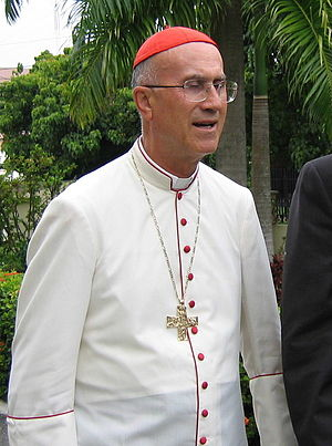 Tarcisio Cardinal Bertone in dress for hot tro...