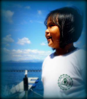 Ricci during a dolphin show in Ocean Adventure