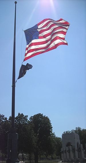 USA flag at half-mast during Memorial Day. The...