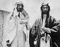 1918. Emir Feisal I and Chaim Weizmann (left, also wearing Arab garb as a sign of friendship)