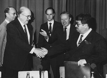 English: Davos Détente, a historic handshake b...
