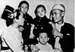 A family portrait, with Aung San Suu Kyi (in white) as a toddler, taken shortly before her father's assassination in 1947.
