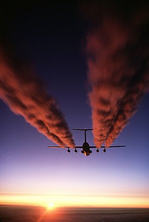 Aircraft leaves a contrail in sky. Kane Minks