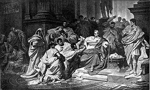The senators encircle Caesar.