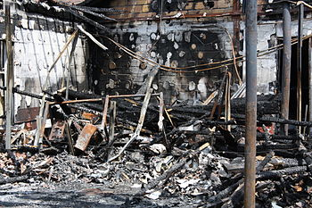 English: Burned shop in the town of Dourdan, F...