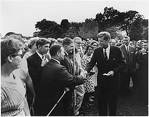John F. Kennedy greets volunteers on August 28...