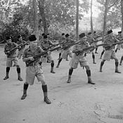 Men of the Malay Regiment wearing peci at bayonet practice