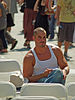 English: Man in a tank top style known as an A...