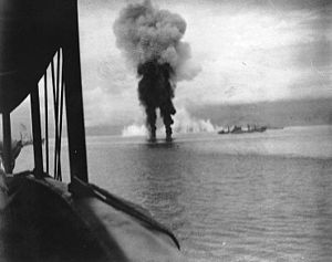 Smoke rises from two Japanese aircraft