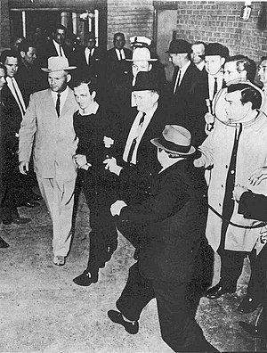 Lee Harvey Oswald being shot by Jack Ruby as O...