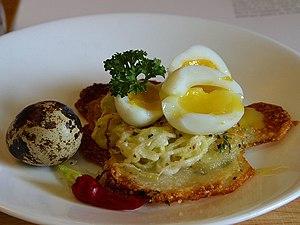 Potato galettes with quail eggs.