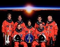 Parazynski, Robinson, Mukai, Duque, Glenn; Bottom: Lindsey, Brown