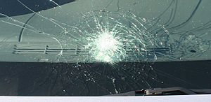 "Automobile windshield displaying ""spiderw..."