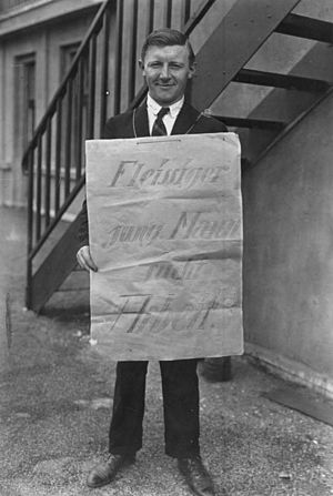 Unemployed man looking for a job in 1928