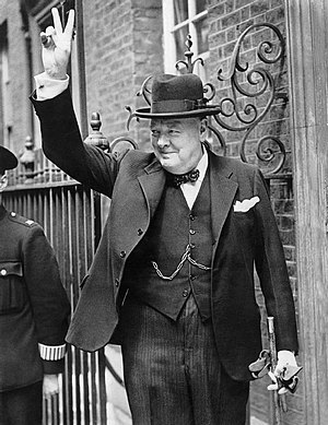 Winston Churchill in Downing Street giving his...