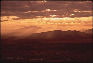 SUNRISE OVER SUPERSTITION MOUNTAINS. URBAN SPR...