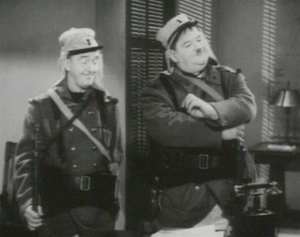 English: Stan Laurel and Oliver Hardy as Frenc...