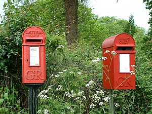 English: Postbox for letters and bird box. Woo...