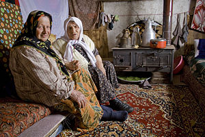 Two woman in a traditional chalet in the summe...