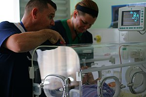 English: Nurses working to bring comfort to a ...