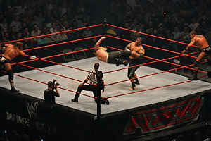 Jeff Hardy performing a low dropkick on Umaga....