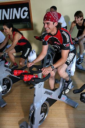 English: Spinning instructor Nederlands: Spinn...