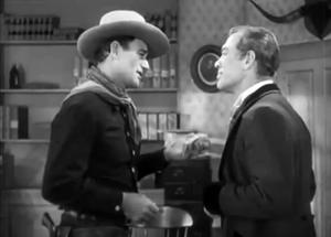 John Wayne and Ward Bond in Tall in the Saddle...