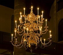 An Antique Chandelier With Candles In Amsterdam S Portuguese Synagogue