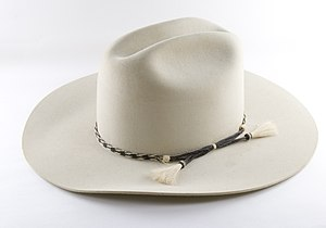 Felt beige cowboy hat on a white background