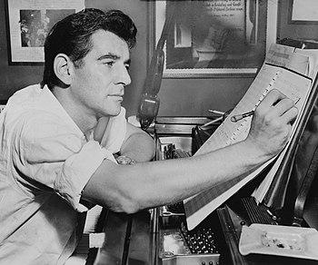 English: Leonard Bernstein seated at piano, ma...