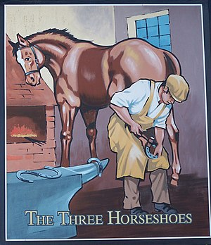 English: Sign for the Three Horseshoes Showing...