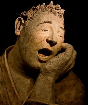 Aching tooth: This statue is in the window of ...