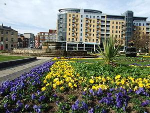 English: BBC Building seen across floral displ...