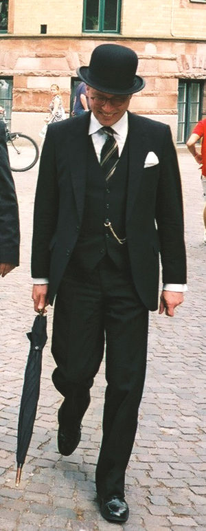 Gentleman wearing bowler hat and three-piece suit