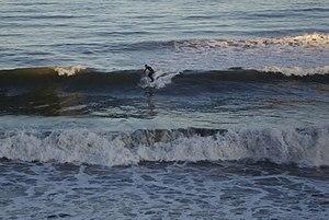 English: Surfing at Aberdeen A lone surfer mak...