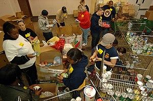 English: NORFOLK (Feb. 19, 2009) Sailors sort ...